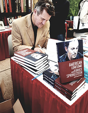 Author Gavin Cologne-Brookes signing books in Louisiana